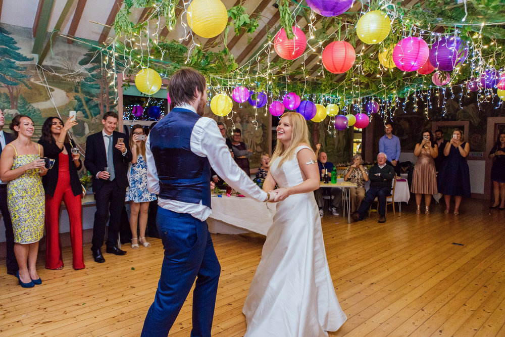 Bride and Grooms first dance at colourful DIY wedding in a New Forest Village Hall