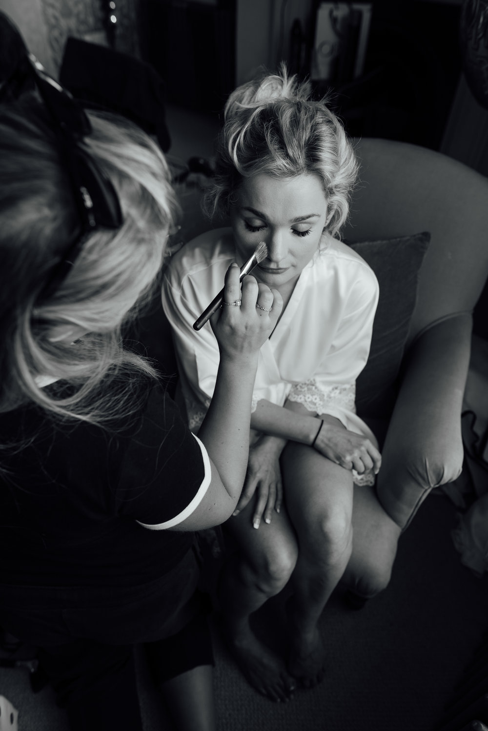 Black and White image of Bride getting ready at The George in Rye East Sussex wedding venue by Amy James Photography - Wedding photographer Hampshire