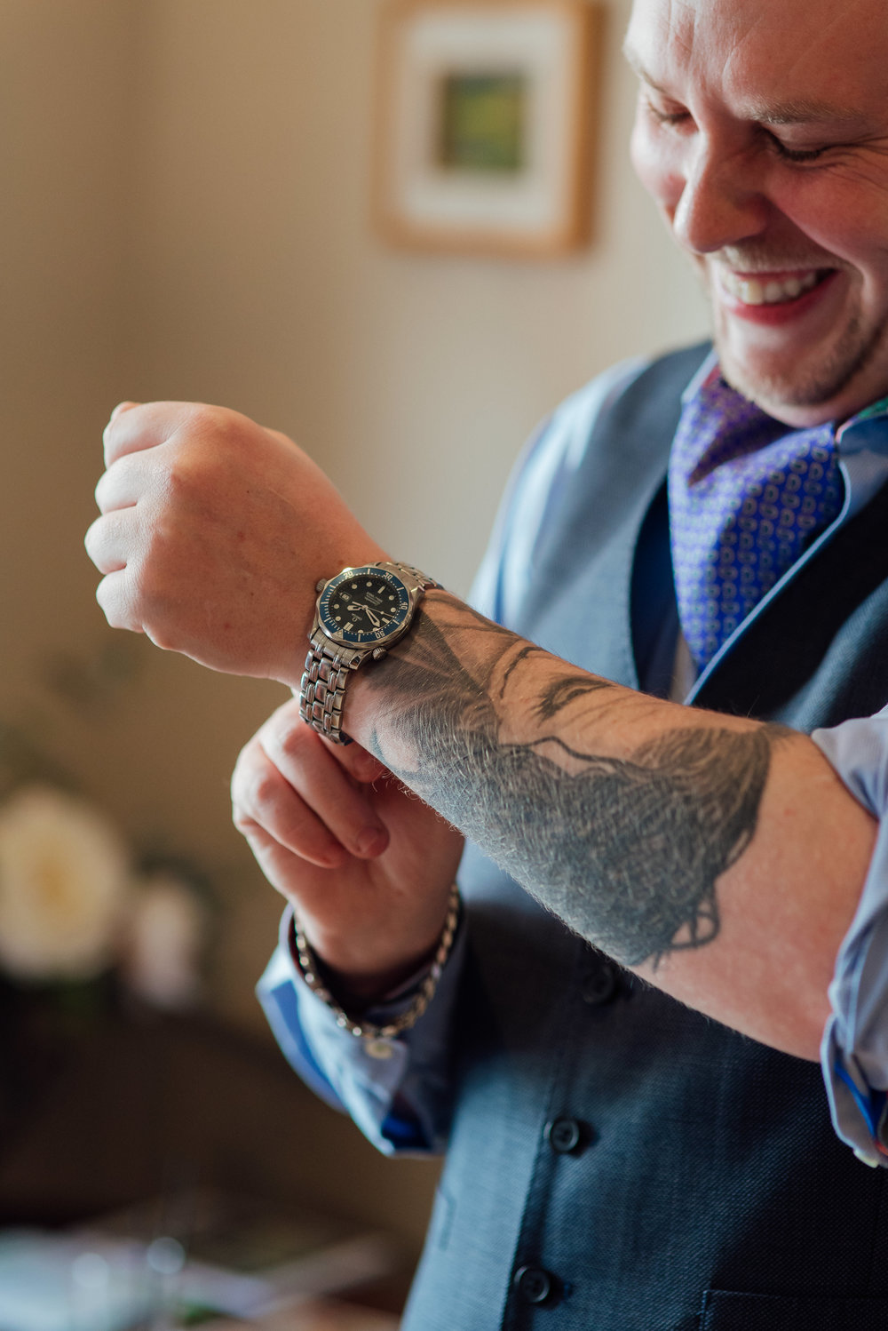 Groom cutting watch on at The George in Rye East Sussex Wedding Venue by Amy James Photography documentary wedding photographer Hampshire Surrey and dorset