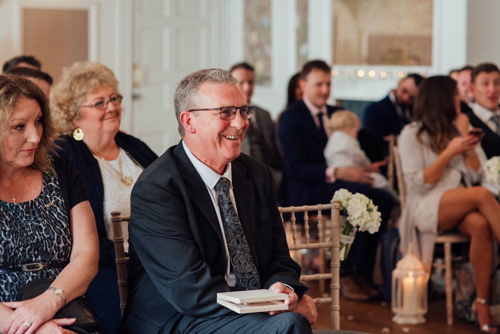 dad watching son get married at a The George in Rye wedding ceremony - Amy James photography - Documentary wedding photographer Hampshire