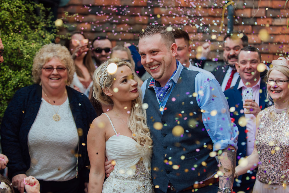 bright colourful confetti at a George in Rye Wedding by Amy James Photography Hampshire wedding photographer