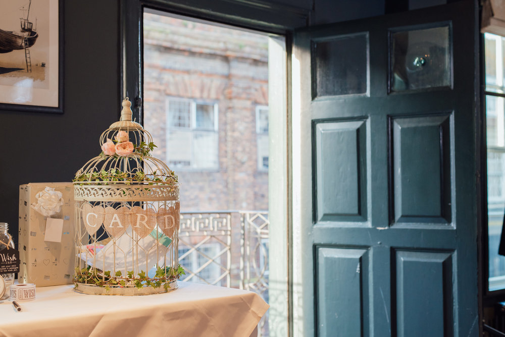 wedding bird cage at the George in rye by Amy James photography