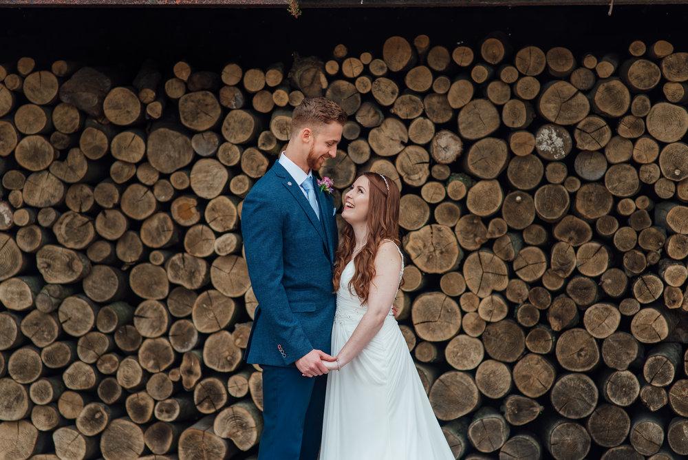 bride and groom portrait at bury-court-barn-wedding-venue wedding-photographer-hampshire wedding-photographer-fleet documentary-wedding-photographer barn-wedding-inspiration