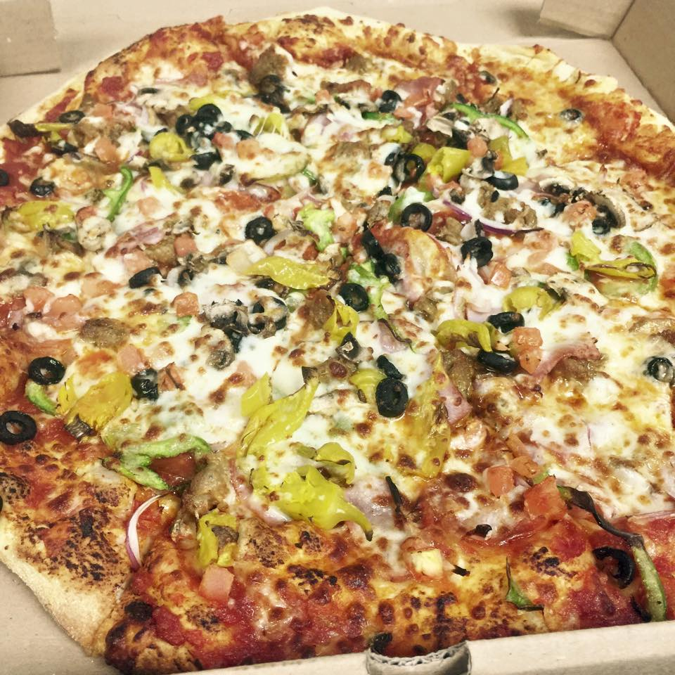 2. Pie In The Sky - Pizza  - This pizza has everything on it, pepperoni, ham, sausage, onions, peppers, black olives, tomatoes, mushrooms, and banana peppers. We can see why it's a fan favorite!
