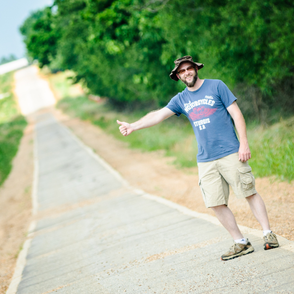 Photographer David J. Schwartz hitching a ride on The Sidewalk Highway Near Afton OK.