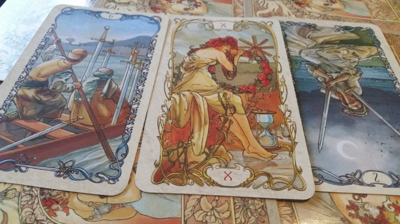 Here is the Tarot Mucha deck once more: The Six of Swords, the Wheel of Fortune, and the Two of Swords Inverted.