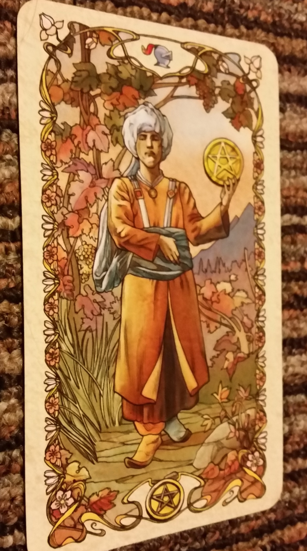 The Knave of Pentacles is wearing an orange shoe and a blue shoe: Broncos colors.