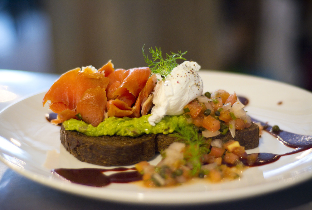 Avocado Toast & Smoked Salmon   pumpernickel toast, poached egg, smoked salmon, tomato & capers, mole drizzle