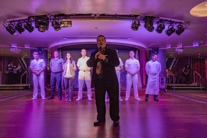 Wee Jimmy introduces the senior officers of Carnival Breeze.