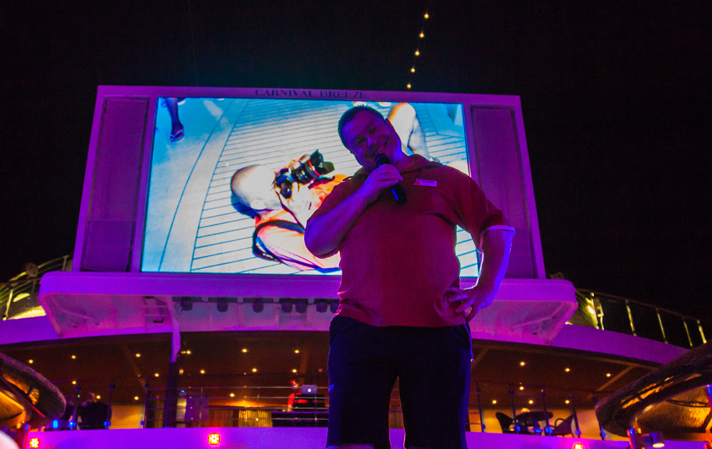 A fun accidental shot where I am seen on the big Lido Deck screen while I am on the deck taking a picture of Wee Jimmy!