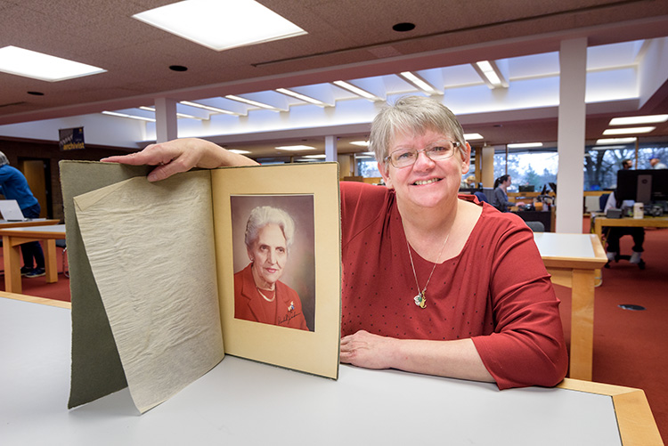 Deb Anderson with a photo of her grandmother and Youth For Understanding Founder Rachel Andresen. Photo taken by Doug Coombe.