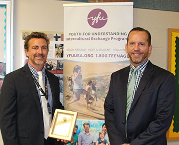 Jason Schrock, principal at Howell High School, receives 2017 Education Innovation Award from Scott Messing.