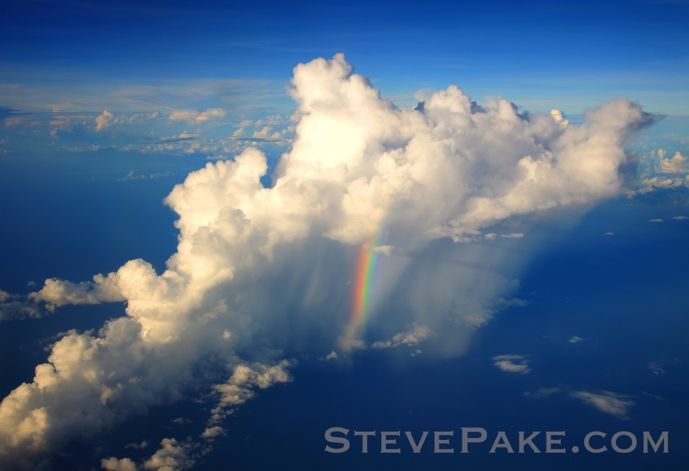A rainbow in the middle of a tropical shower in the Caribbean from the air, and on our side of the plane. This only lasted a few seconds as we were flying by, and it was spectacular. Always have your camera with you and ready!