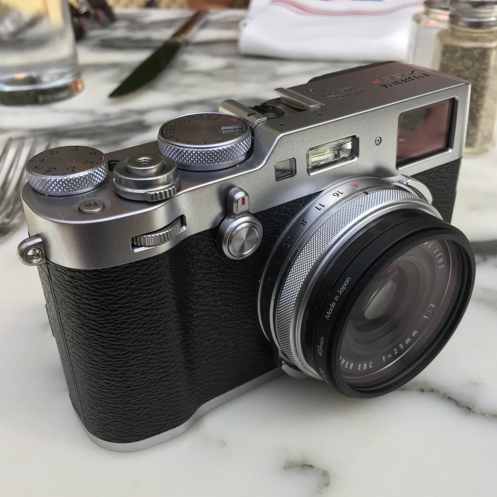 For my more casual photography as of late, this Fuji X100F has been all I've needed. It's much smaller and lighter than a single DSLR body without a lens, and you still need to pack lenses for the DSLR cameras!