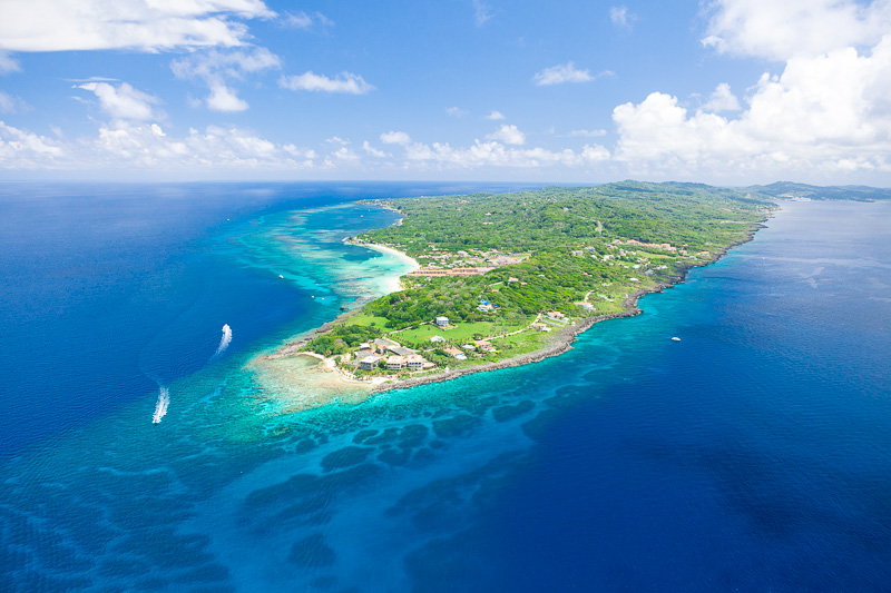 "An aerial photo of the northwestern ""point"" of Roatan taken by Devon Stephens - Roatan Photography"