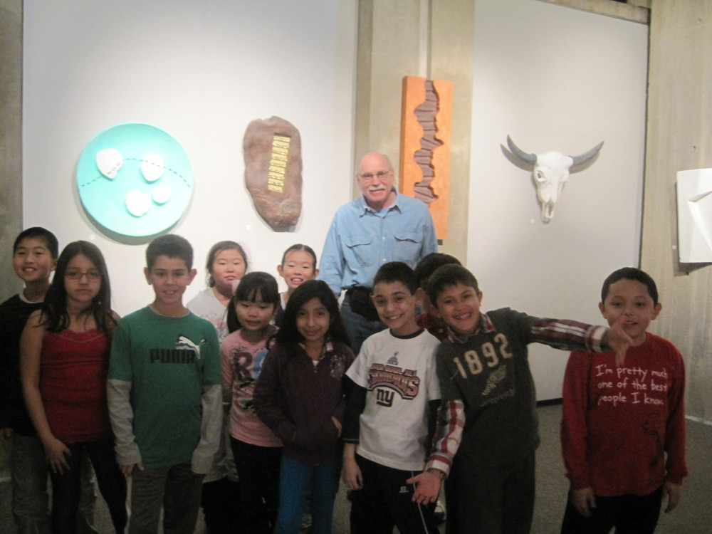 Art program at local Library. Elementary students tour artwork with the artist.