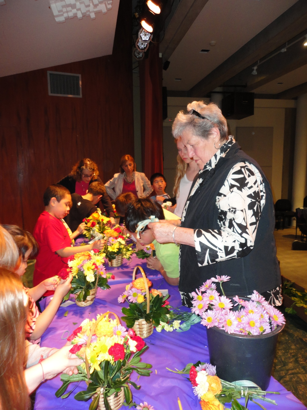 After school program - students creating Mother's Day floral craft with local florist.