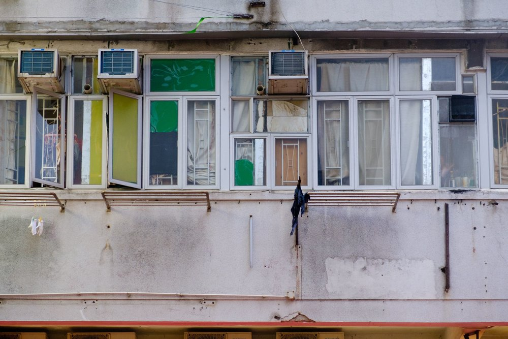 The price of rents in Hongkong are enormous, that's why people subdivide their rooms in smaller units. Officially it is not allowed, however you can notice it when looking on the windows from outside. Every window has a different decoration or even aircon.