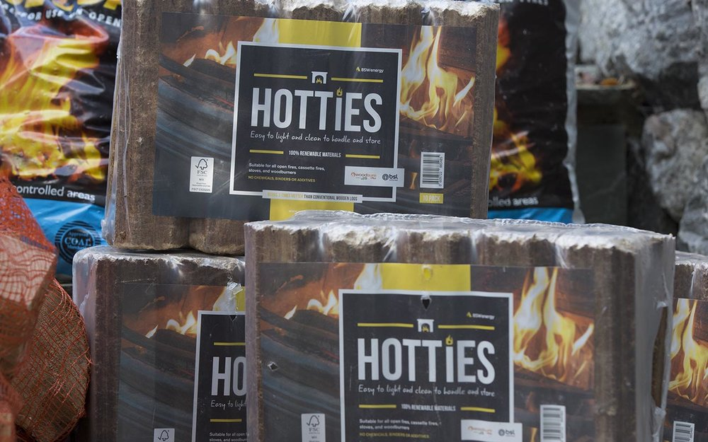 - Hotties Eco-logsWe deliver a high quality brand of eco-logs – Hotties. They are made in the UK by manufacturer Bridgebrooke Energy and they are made from 100% recycled clean wood. They are denser and drier than seasoned logs and other heatlogs and do not expand or crumble, giving off a powerful and reliable heat every time; the average burn time for a single Hotties Heatlog can vary from 60 minutes to 90 minutes (the type of appliance you use will determine the burn time). Manufactured in Suffolk from UK recycled clean wood residues, off-cuts and sawdust, the logs are HETAS/Woodsure Plus accredited for quality assurance every time. You may be able to find other types of fuel logs/briquettes slightly cheaper but we only supply Hotties as we believe they offer the best quality.Highly compressed briquettes, they are made in Suffolk, UK, from 100% recycled UK wood,with no additives.Trial pack (10 heatlogs) for £7.00 when you make a purchase kiln dried logs, smokeless coal or house coal.From then on minimum purchase 10 packs @ £7.00/pack - £70.00.