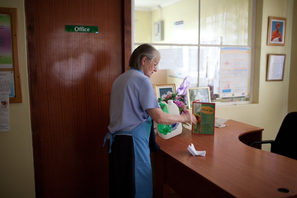 Sister Eileen collects bottles before heading out of the hospice for the day. She manages all aspects of the hospice at the age of 81, with no sign of halting immediately. She personally speaks with all families when their loved ones are admitted to the hospice, and when they come after death.