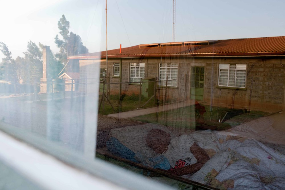 Teresiah Wairimu, 67, lies in her bed at dusk. Depending on the health and physical capabilities of patients, Sister Eileen and the nurses will do whatever they can to make the comfortable - whether it be helping them outside to sit in the sun or finding their favorite book. No matter the patient's condition, the staff at the hospice make every effort to help those they care for live their days with some sense of comfort and free of pain.