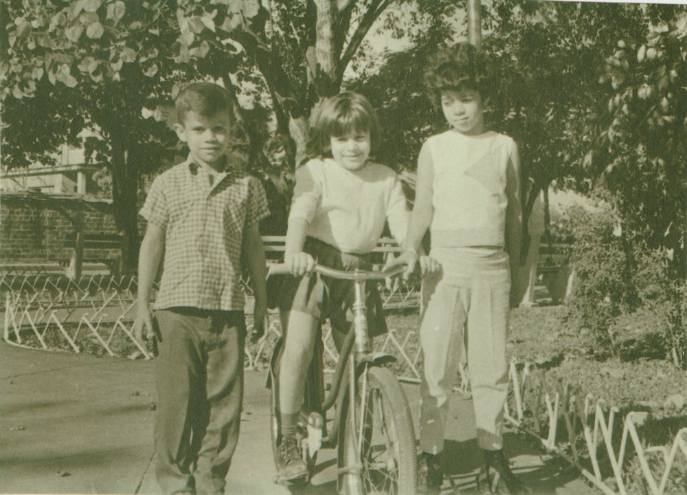 "My mother, Carmen, during her last year in Cuba around age 8 with two friends in a park near her house. ""My father used to sit on the bench and would watch me ride my bike,"" she remembers."