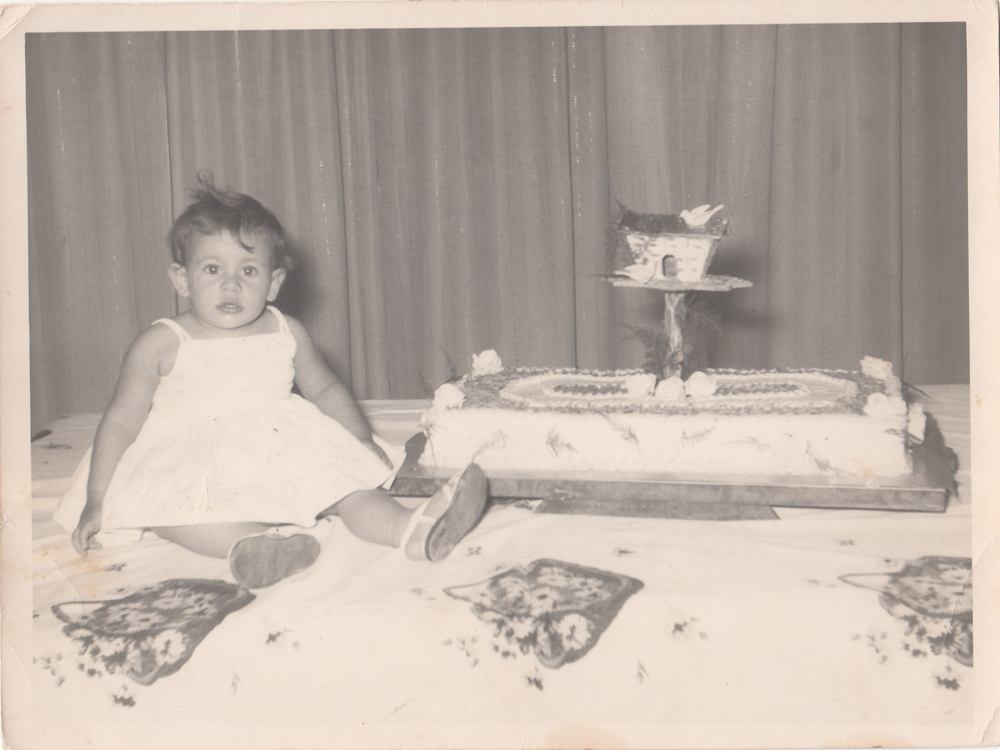 My mother on her 1st birthday at home in Bayamo.