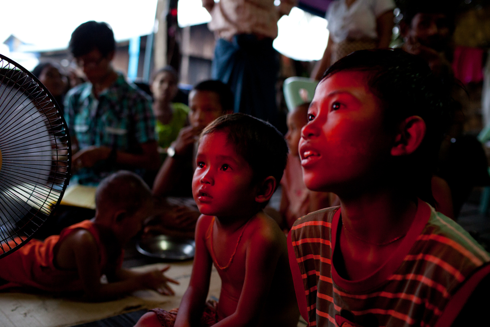 Thin Htet Aung and his cousin, Lau Lau, watch an episde of Tom and Jerry with Burmese subtitles. The two cartoon characters can be seen all over around the home - on backpacks, notebooks, pens, shirts, pajamas. Every night, both the children and the adults gather around the television to watch the cartoon on one of Myanmar's public television stations.