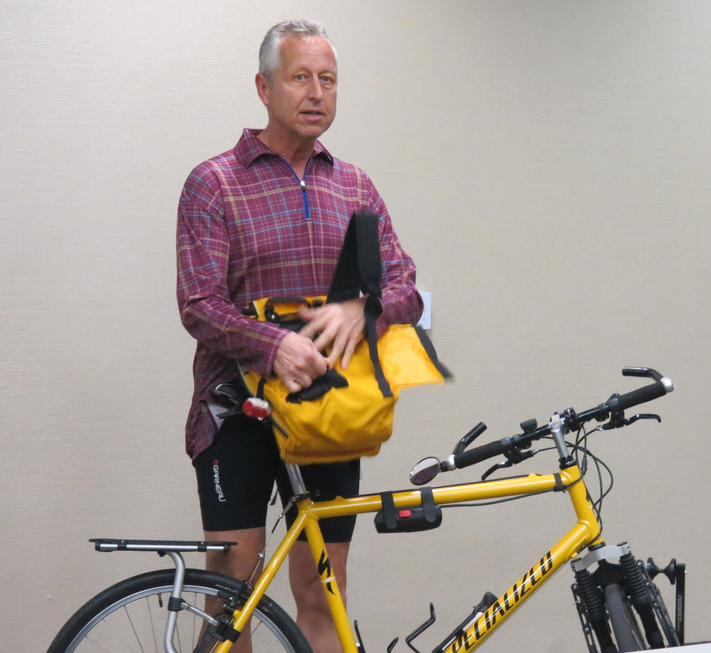 Secretary Bob McHenry  showed some of his economical modifications to an old hard tale ATB that is now his touring bike.
