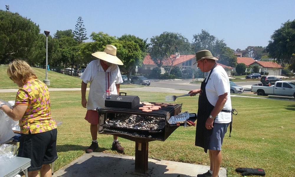Chef Penny, Line-chef Bill & sous chef Paul grilling at our 2015 BBQ will be grill masters again this year