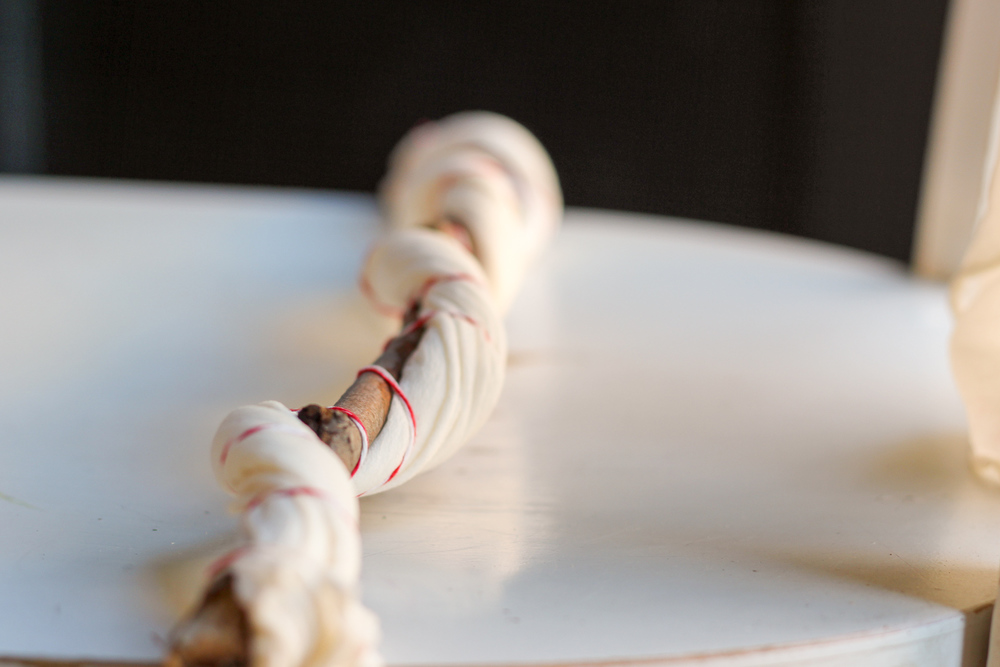 Tying up silk before dying.