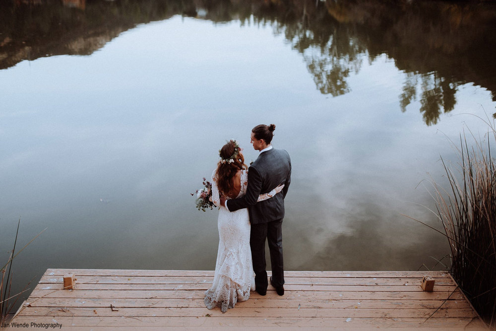 Couple-on-dock-looking-over-the-water.jpg