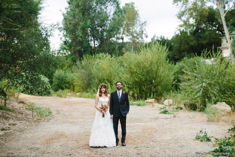 holding-hands-malibou-lake-lodge-wedding-.mary-costa-photography.jpg