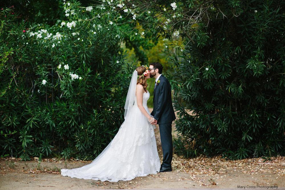 wedding-kiss-on-malibou-lake-lodge-grounds-mary-costa-photography.jpg