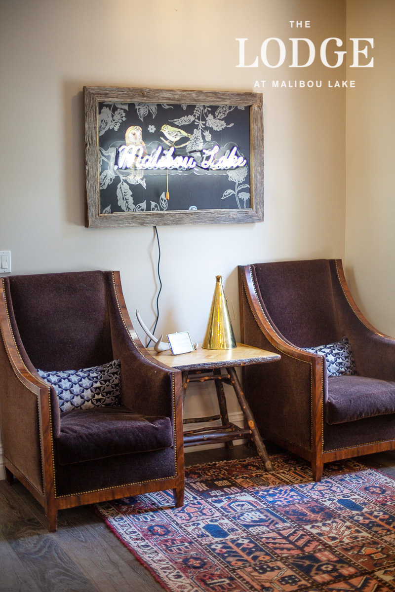 Bar - neon sign and brown mohair chairs.jpg