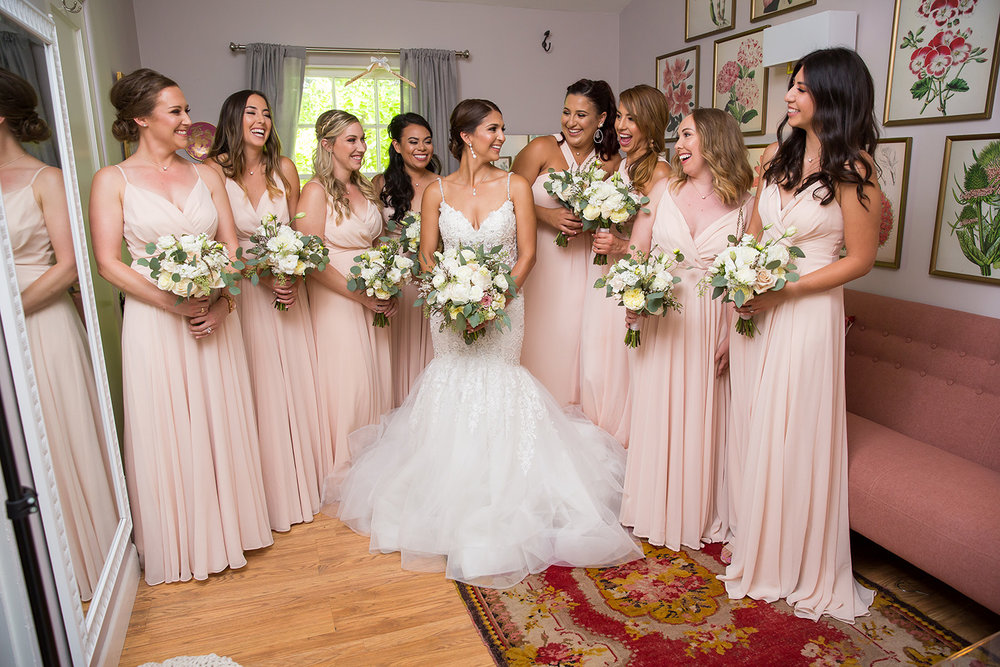 Bride and ladies in pink room.jpg