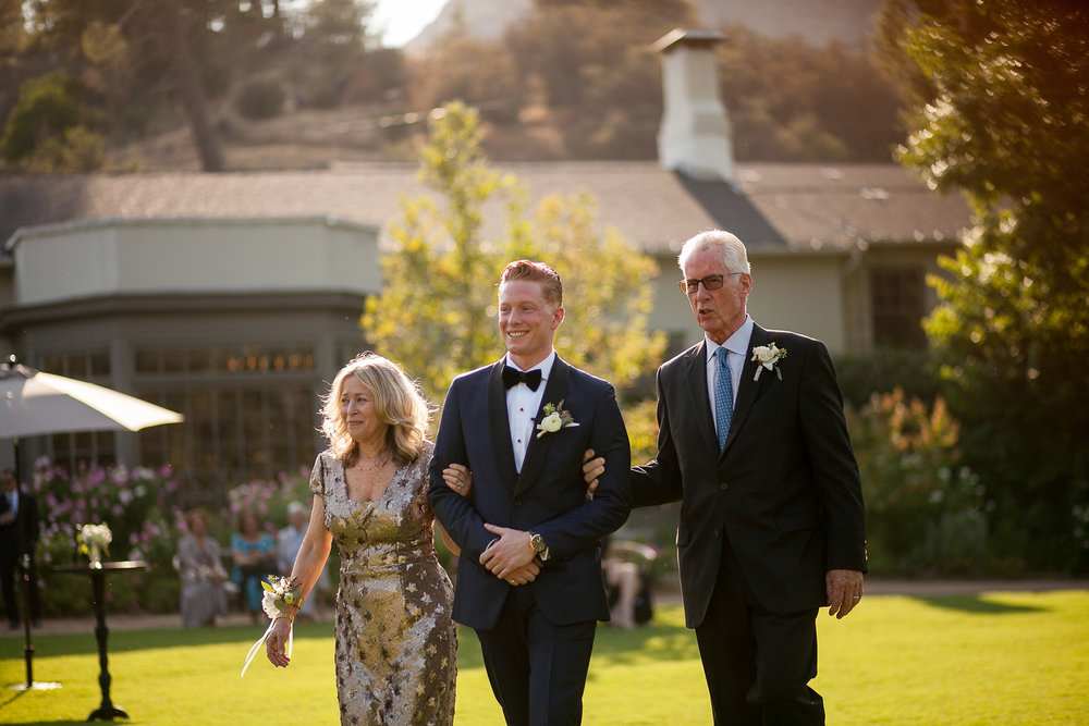 Groom and parents walk down the aisle.jpg
