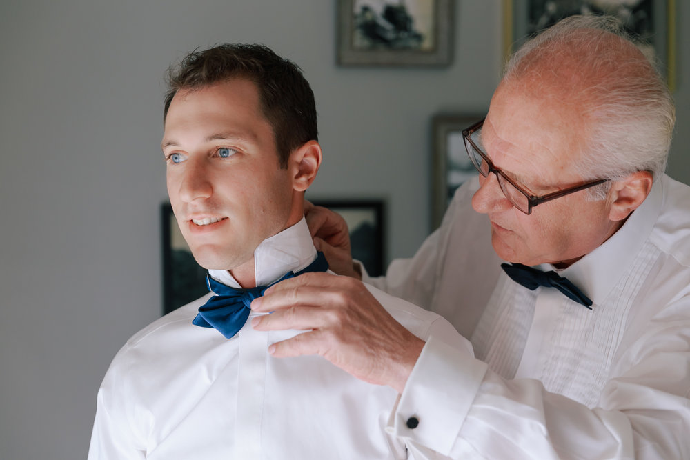 C&M groom and father prepare.jpg