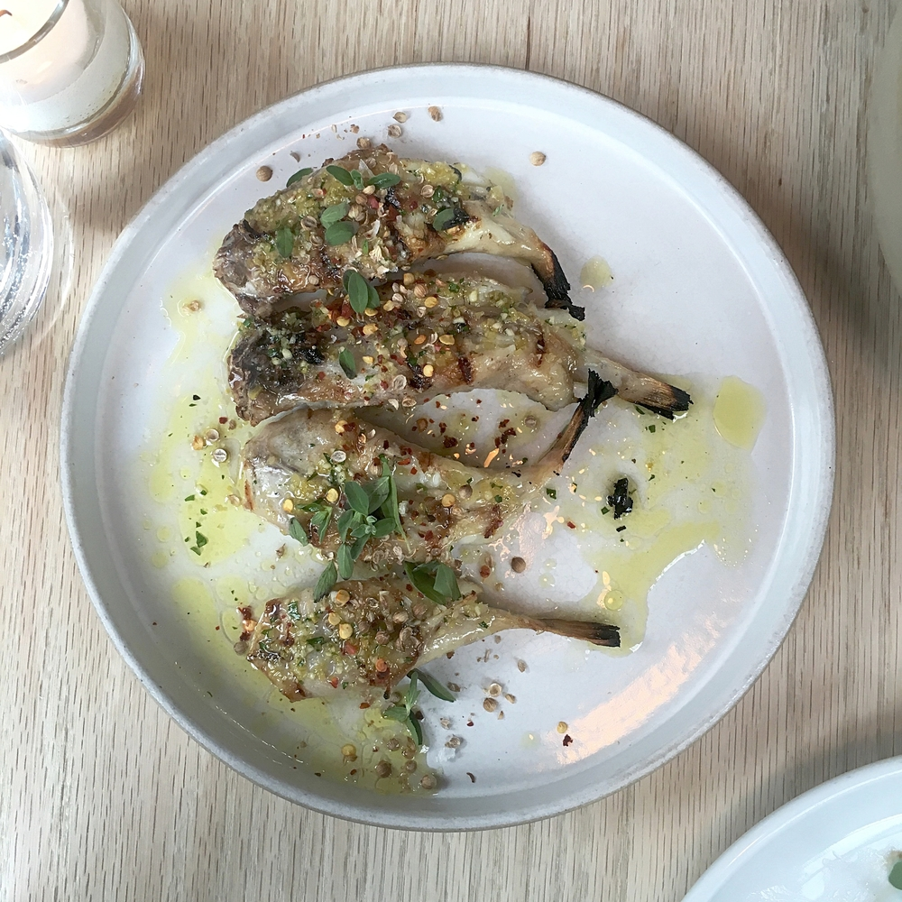 grilled blowfish tails, salmoriglio, cracked coriander