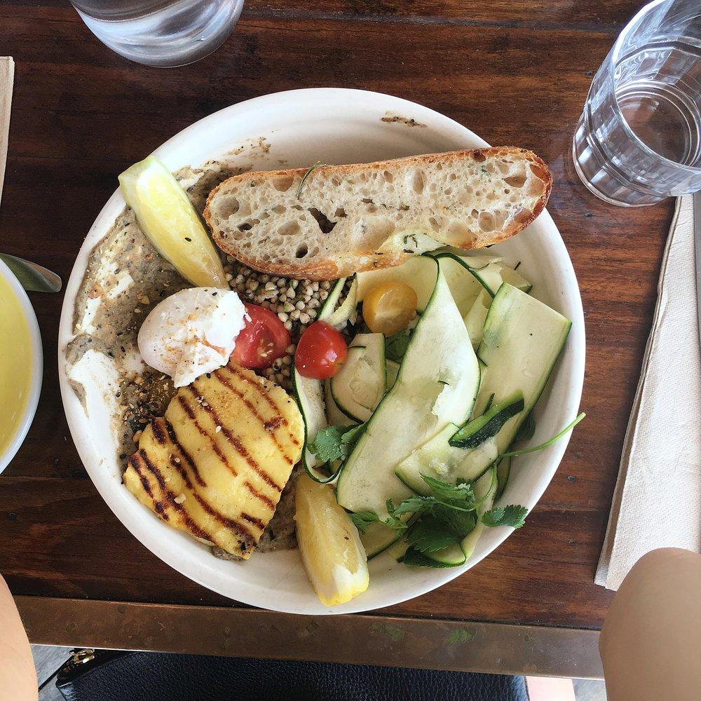 farm bowl, grilled haloumi, poached egg, babaganoush, buckwheat tabouli, tomato, zucchini, mint, dukkah & foccacia
