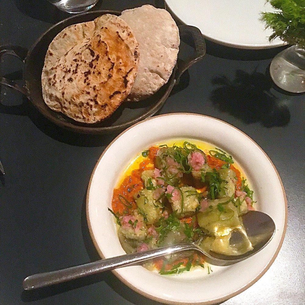 roasted eggplant, carrot-hazelnut romesco, whole wheat pita