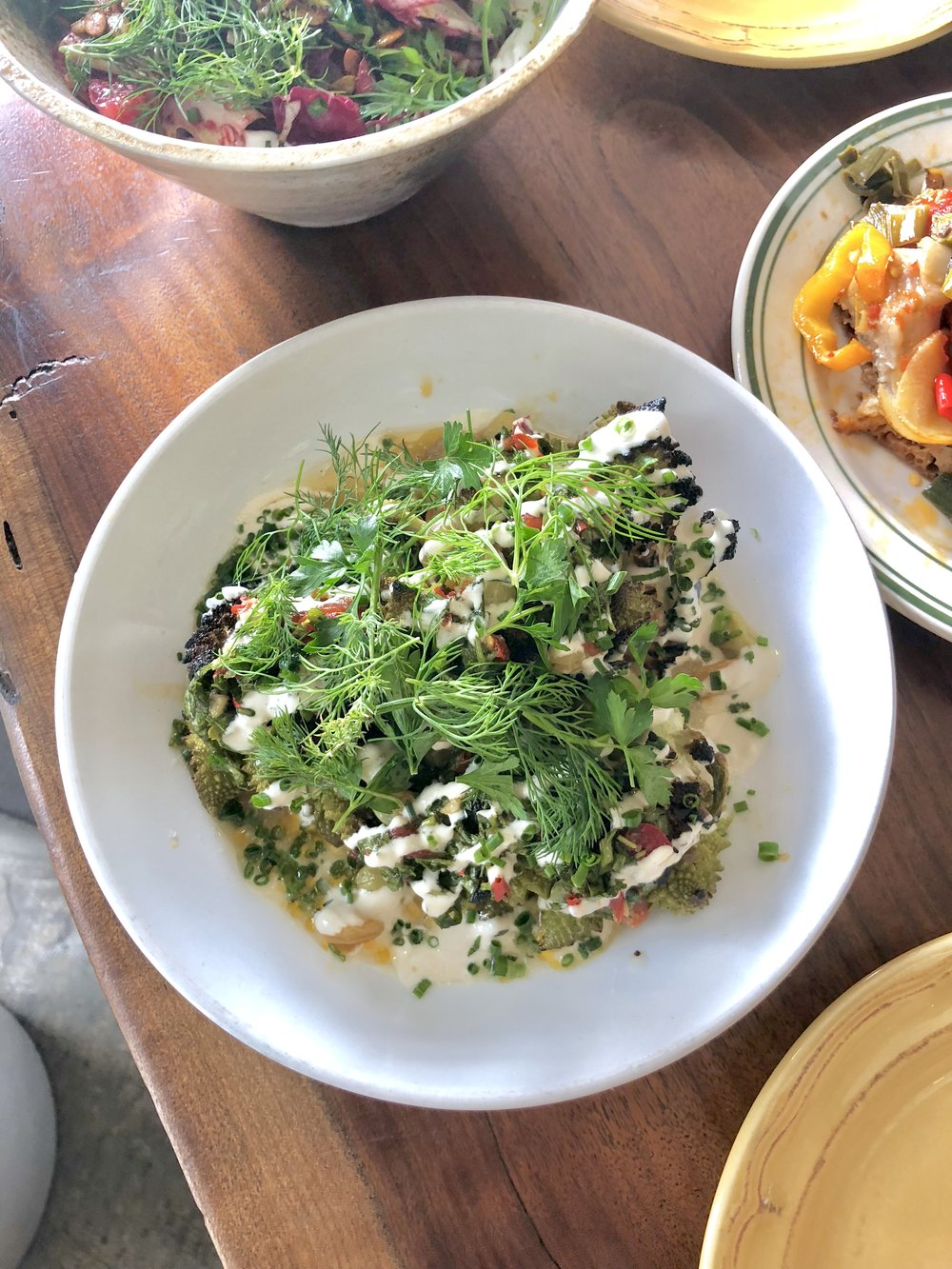 wood fired romanesco // tahini, pickled raisins, chermoula