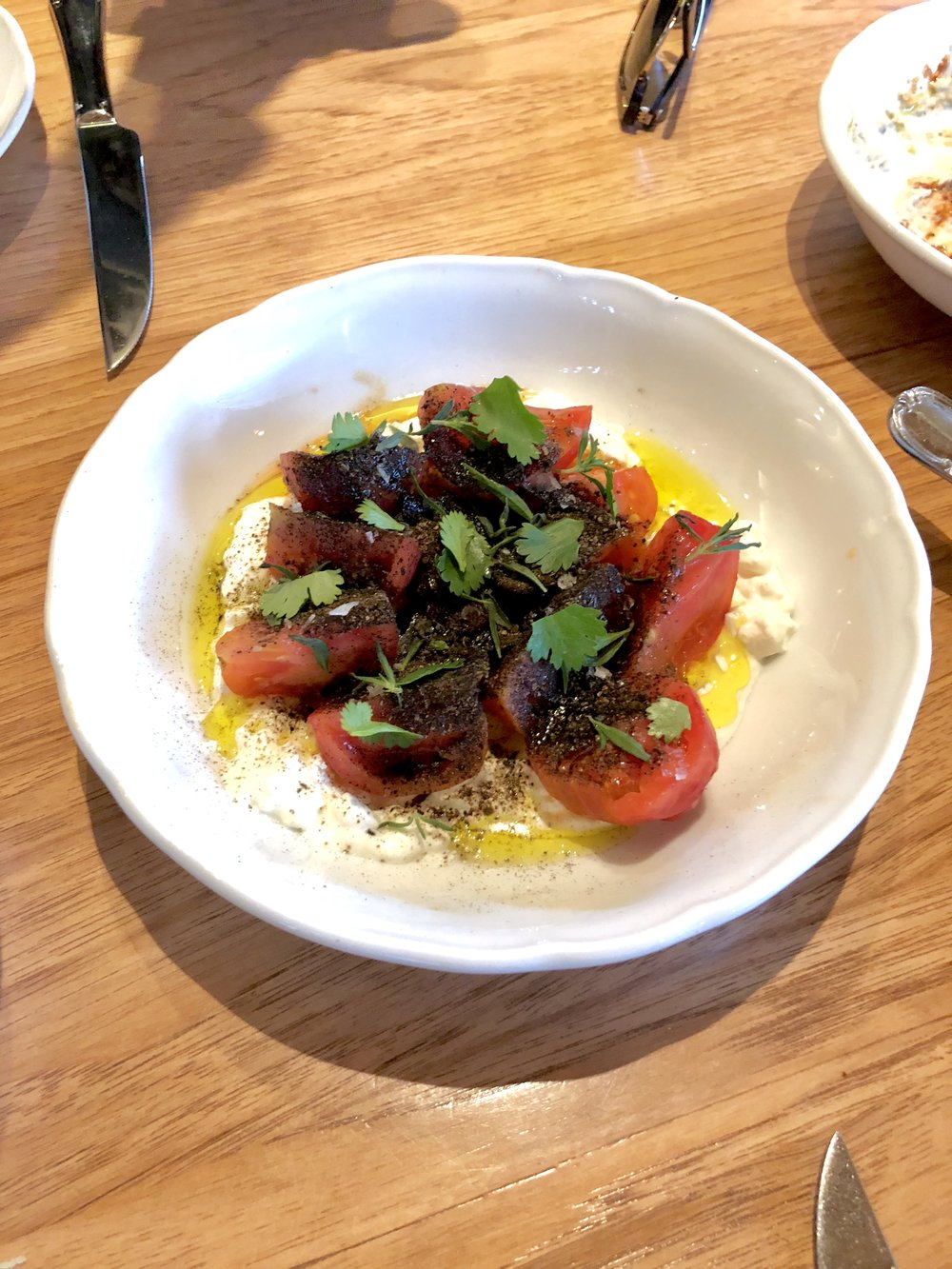 marinated tomato // whipped feta, smoked eggplant powder, savory, sea salt, olive oil