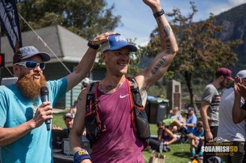 Kevin receiving his Squamish 50/50 finishers hat from  legendary canadian ultra runner gary robbins.