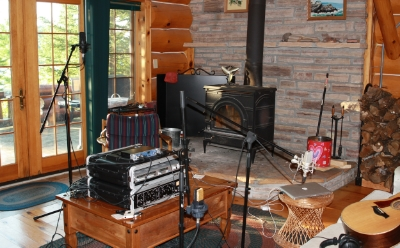 A recording session for Come a Little Closer at the log cabin