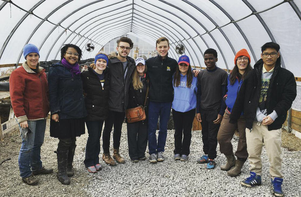 Volunteers from Canisius College at the Massachusetts Avenue Project, an organization that promotes community and sustainability on the West Side of Buffalo, NY.