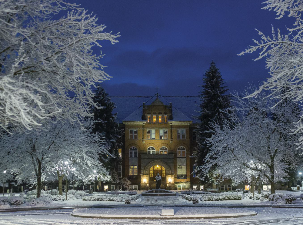 The beautiful serene snow blankets the entrance to  Gonzaga University . Photo by Matt Weigand.