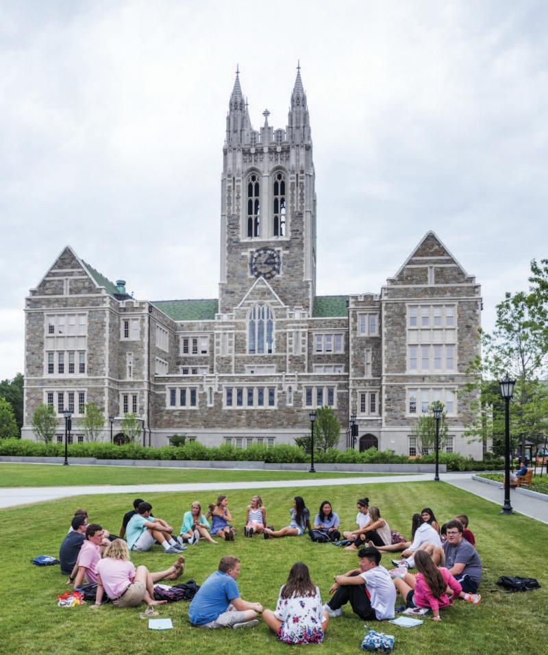 Students engage in meaningful conversation on the campus at Boston College.