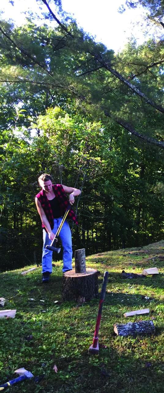 Wheeling Jesuit University students helping community members prepare for winter with wood chopping services.