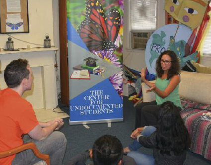 Jennifer Ayala, director of The Center for Undocumented Students, TCUS, is pictured here in a meeting with staff and volunteers for the center. Photo courtesy of Corey W. McDonald, The Jersey Journal.